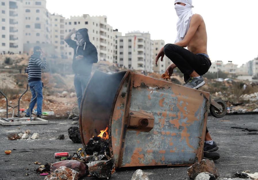 Extremists burning trash.
