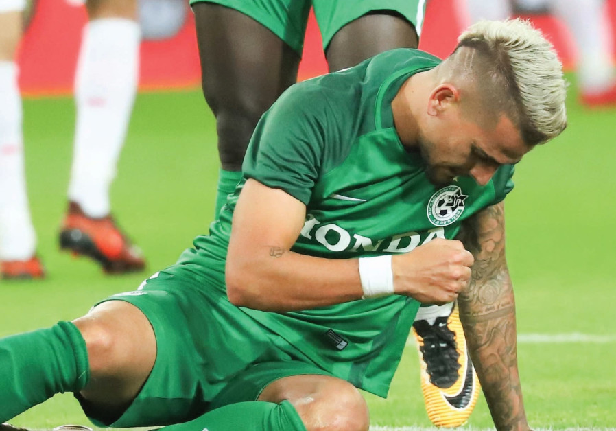 Maccabi Haifa midfielder Maor Buzaglo takes to the pitch after an injury, December 2017