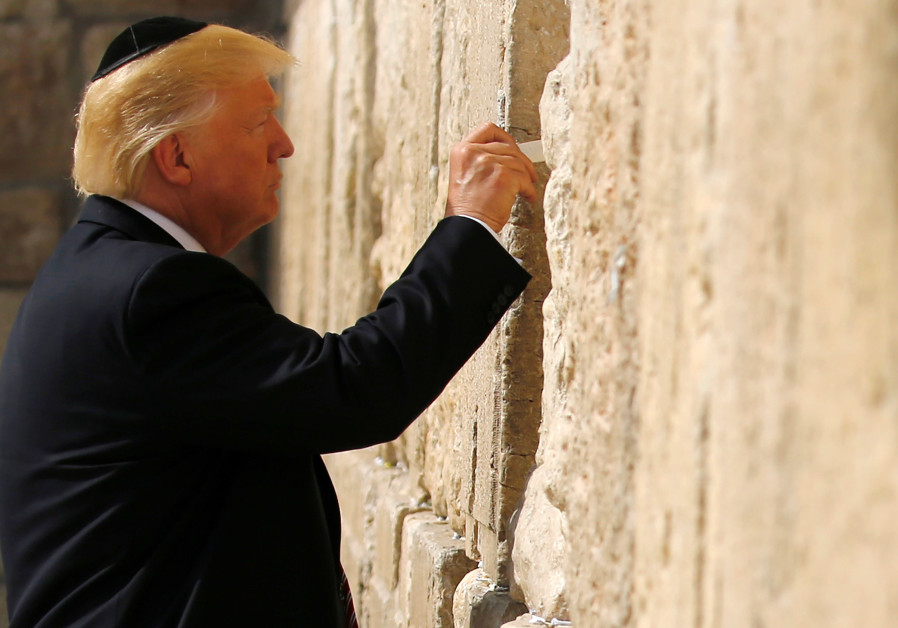 US President Donald Trump leaves a note at the Western Wall, Judaism's holiest prayer site, in Jerus