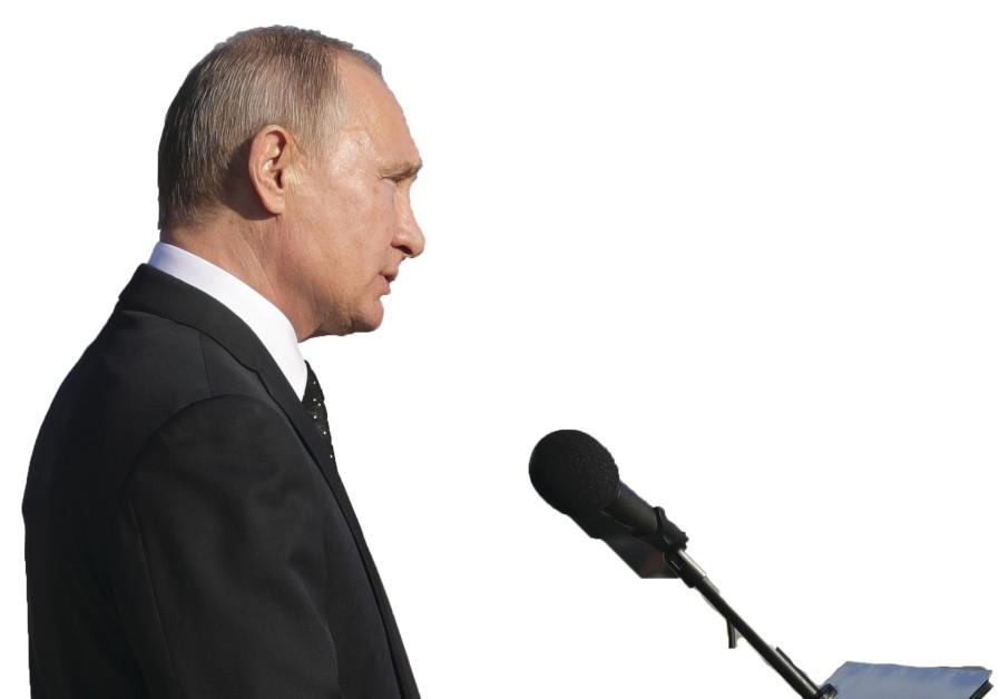 RUSSIAN PRESIDENT Vladimir Putin addresses servicemen as he visits the Hmeymim air base in Latakia P