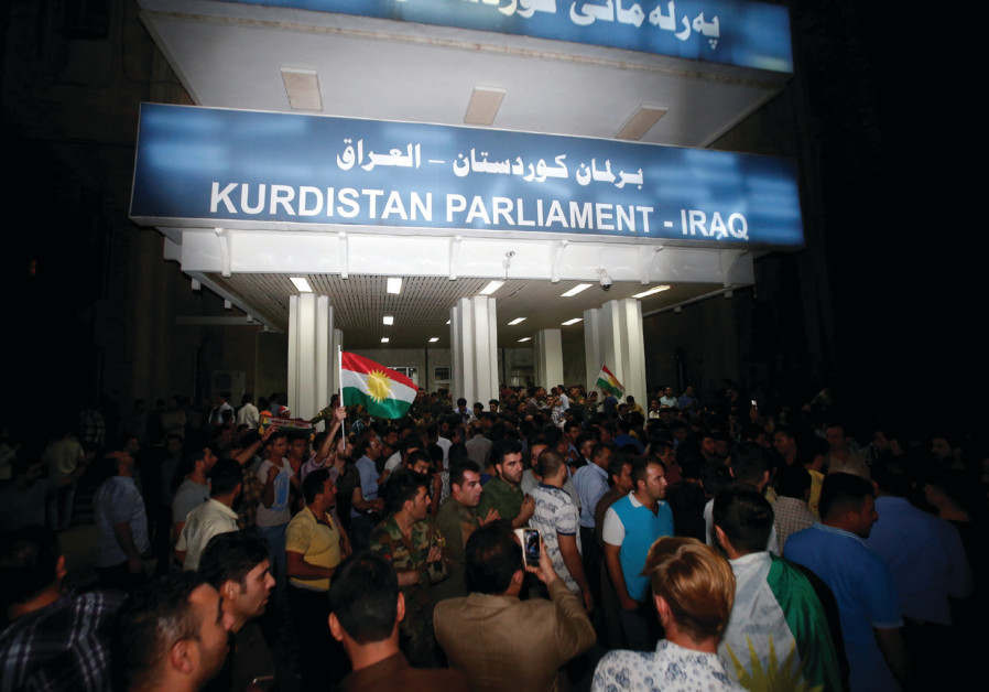 DEMONSTRATORS GATHER outside the Kurdistan Parliament building in Erbil, Iraq, in October 2017