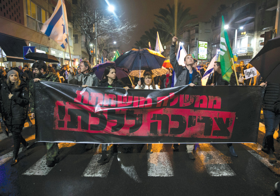 PROTESTERS CALL for the resignation of Prime Minister Benjamin Netanyahu over police investigations