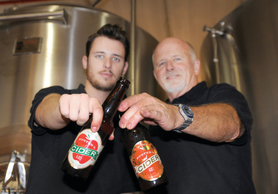 MATT NEILSON (left) and father Denny of Buster's Brewery, with bottles of their apple cider