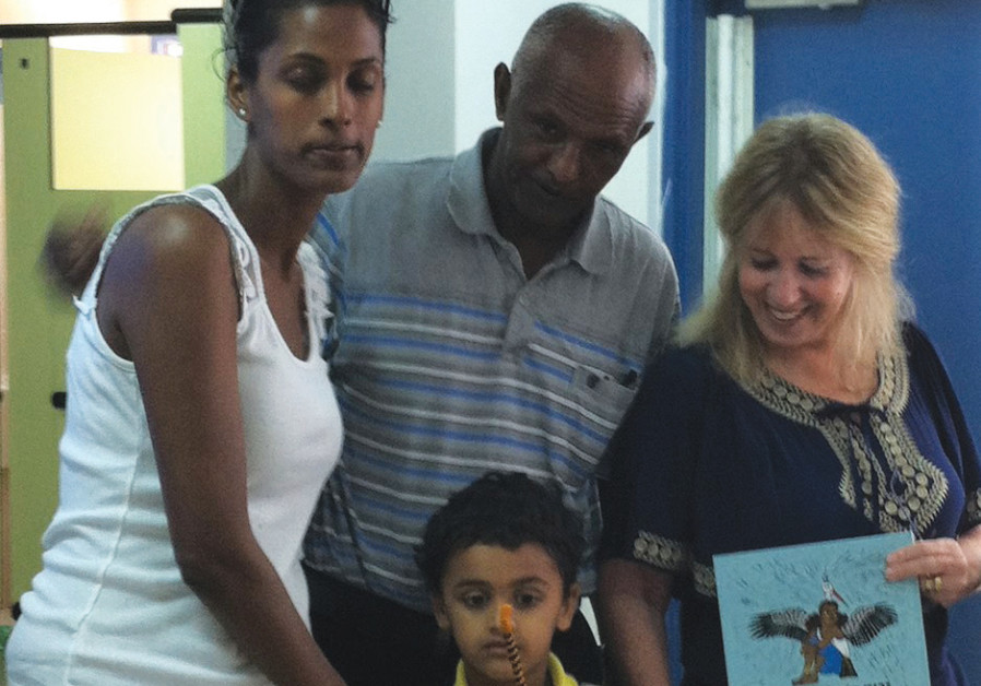 Author Bat-Ami Melnik and Yeshayahu Chana with his daughter and grandson
