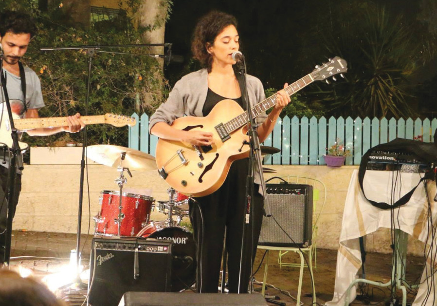 The group Folly Tree performs outdoors at a recent Sofar Sounds concert in Jerusalem