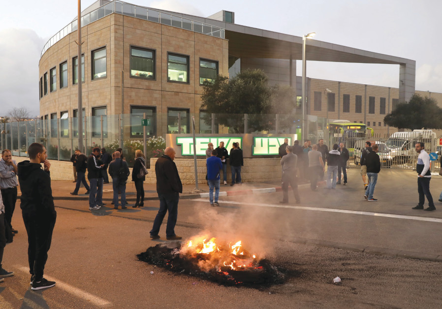 People protest outside a Teva Pharmaceutical Industries facility in Jerusalem on December 14