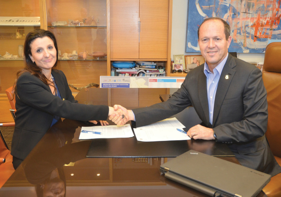 Jerusalem Mayor Nir Barkat and Fleur Hassan-Nahum, a Jerusalem city council member and new deputy ma