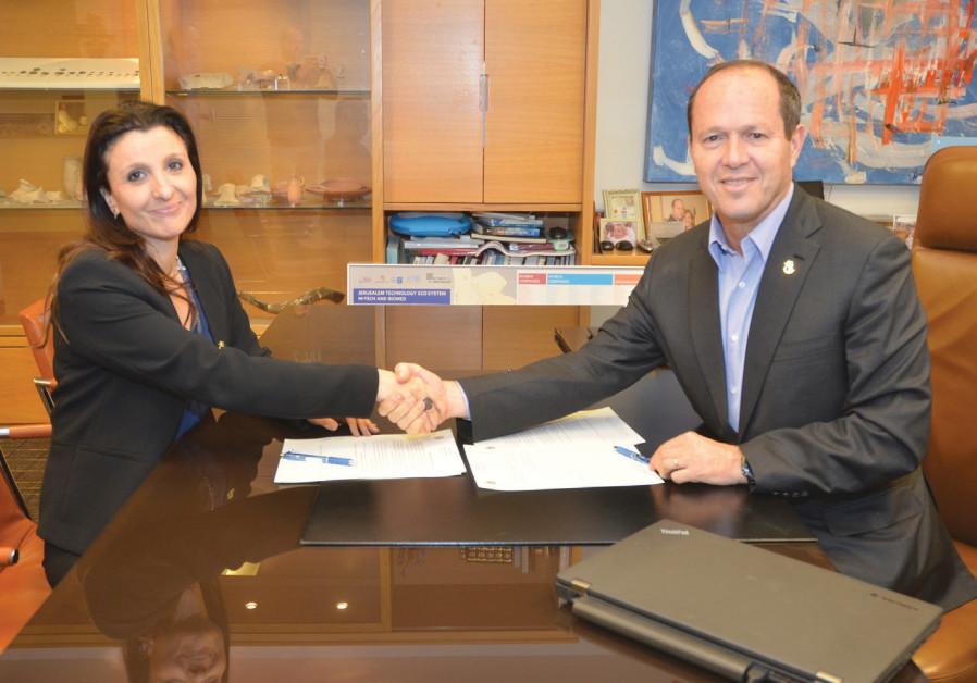 Jerusalem Mayor Nir Barkat and Fleur Hassan-Nahum, a Jerusalem city council member and new deputy ma