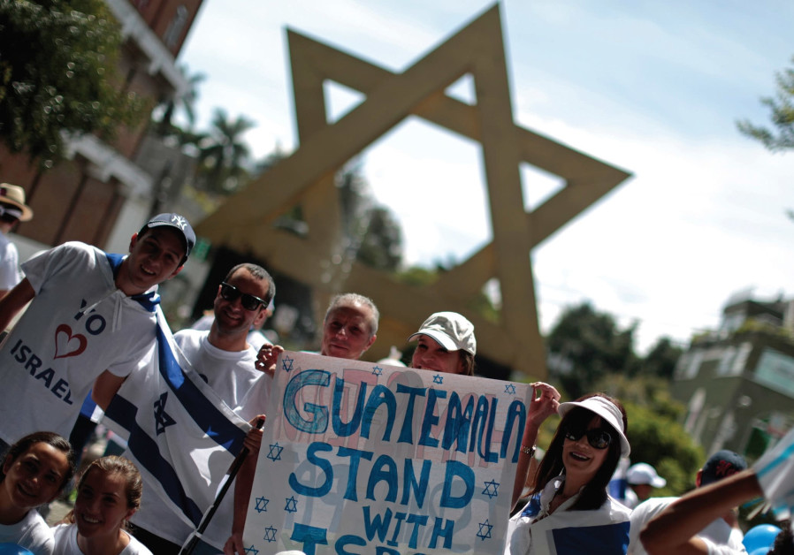 "Guatemalan activists wave Israeli flags near the ""Plaza of Israel"" in the country's capital, 2015"