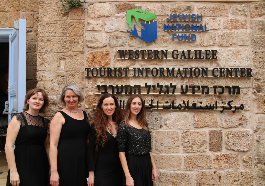Singers pose in front of the Western Galilee Tourist Information Center in Acre