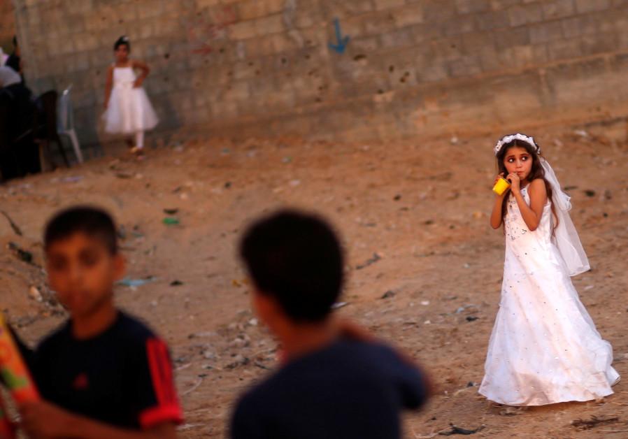 A Palestinian girl attends a mass wedding in Gaza, July 2016