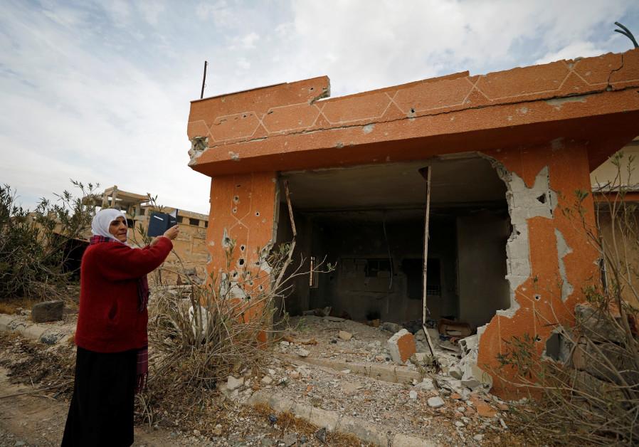 Syria: Mass graves uncovered, Shi'ite militia poised near Israeli border