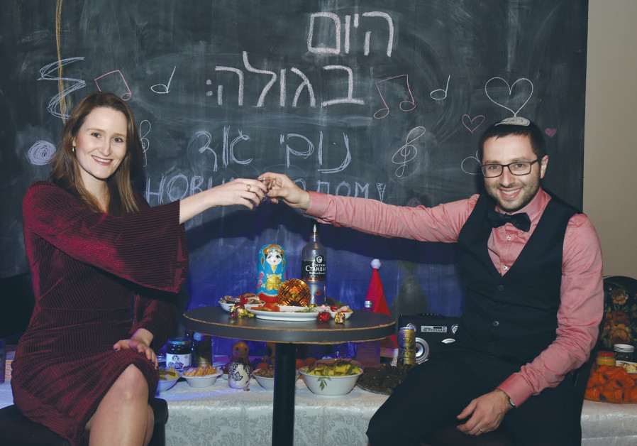 Idit Druyan and Yonatan Dobov of Bayit Yehudi's youth wing celebrate at the 'Russian New Year' part