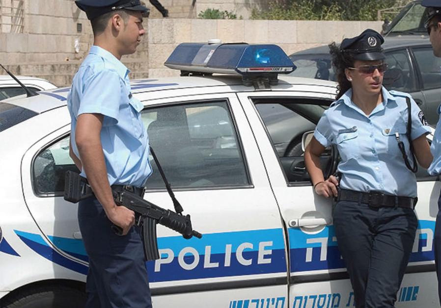 Police chat near a patrol car