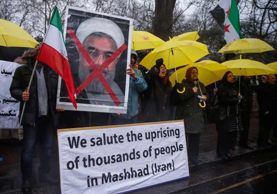 Opponents of Iranian President Hassan Rouhani hold a protest outside the Iranian embassy in west Lon