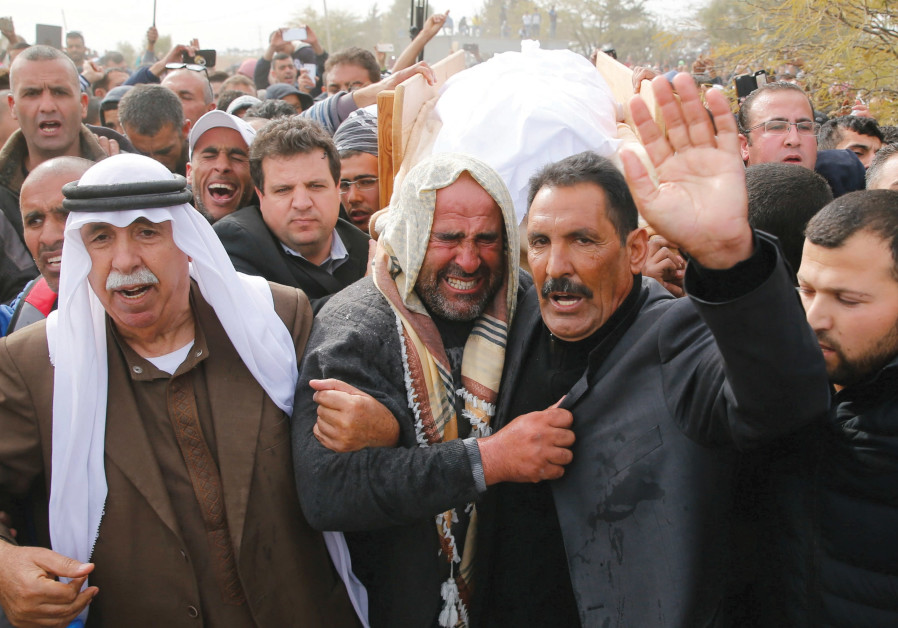 FRIENDS AND RELATIVES carry the body of Ya'qoub Abu al-Qi'an during his funeral in the Beduin villag