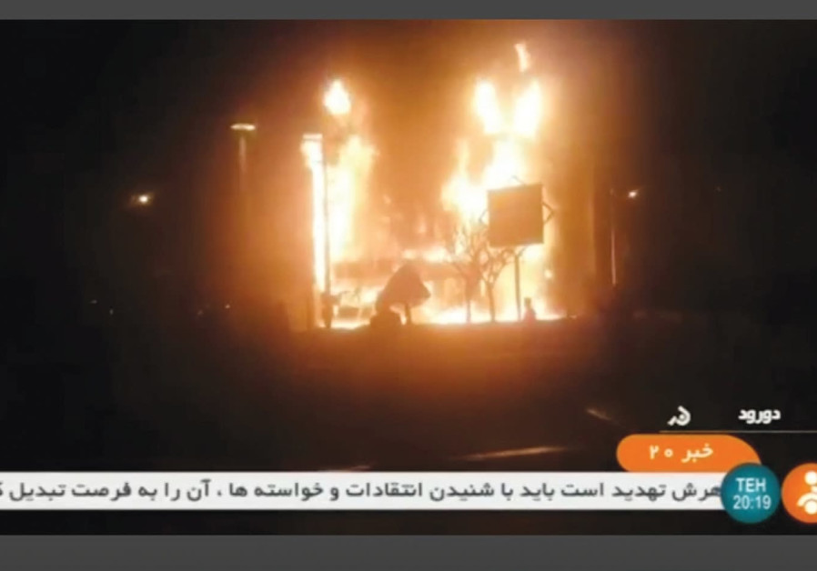 A building on fire is seen in Dorud, Iran, in this still image taken from video on December 31, 2017