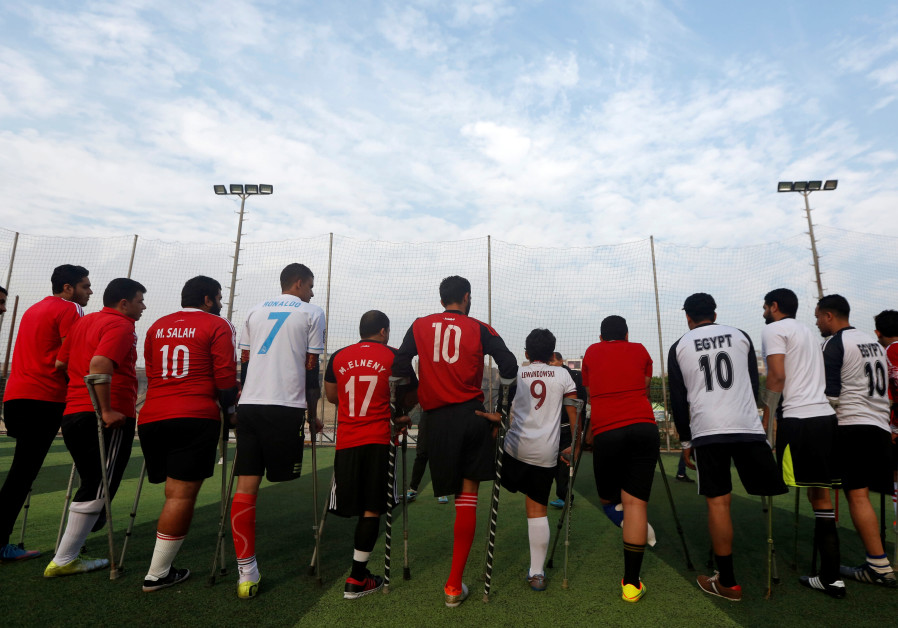 """Members of """"Miracle Team"""", a soccer team made up of one-legged soccer players, listen to their coach"""
