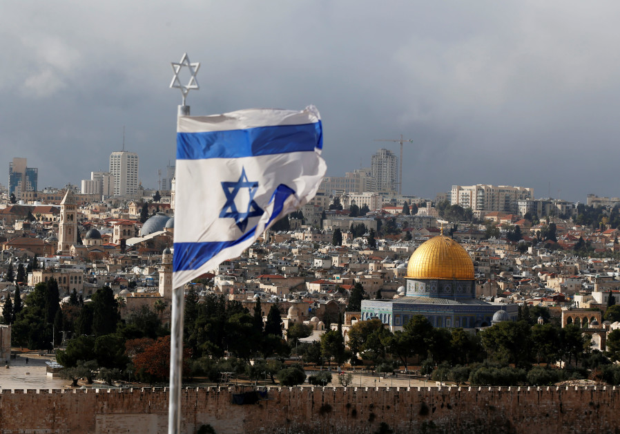 An Israeli flag is seen near the Dome of the Rock, located in Jerusalem's Old City
