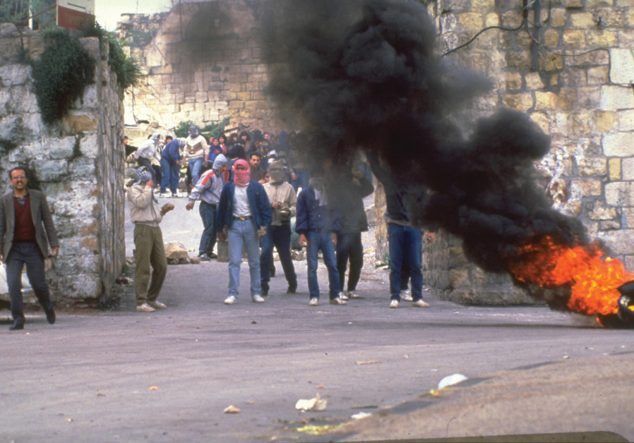 PALESTINIANS BURN tires in a demonstration during the First Intifada in Ramallah in 1988