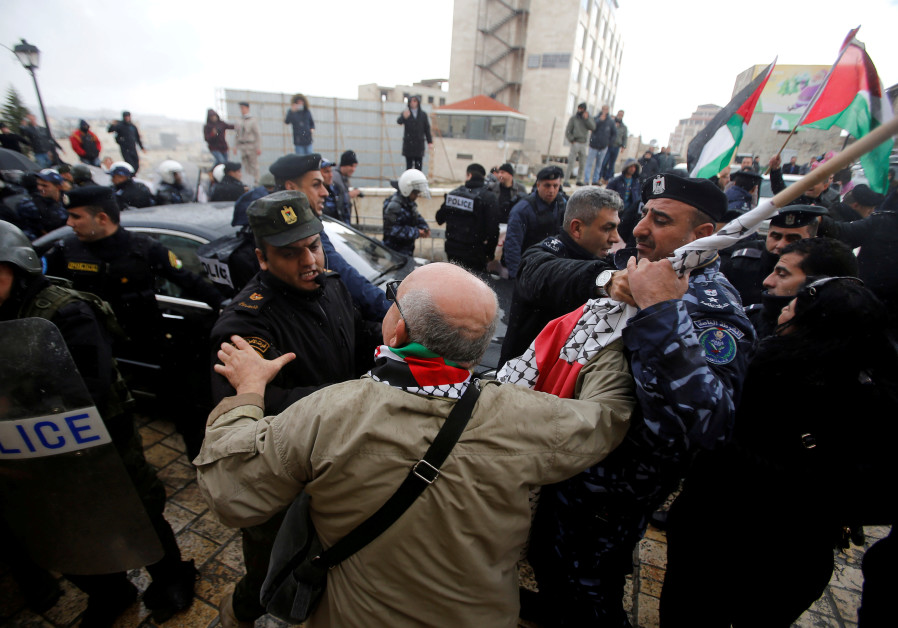 Palestinian security forces push away demonstrators from the convoy of Greek Orthodox Patriarch of J