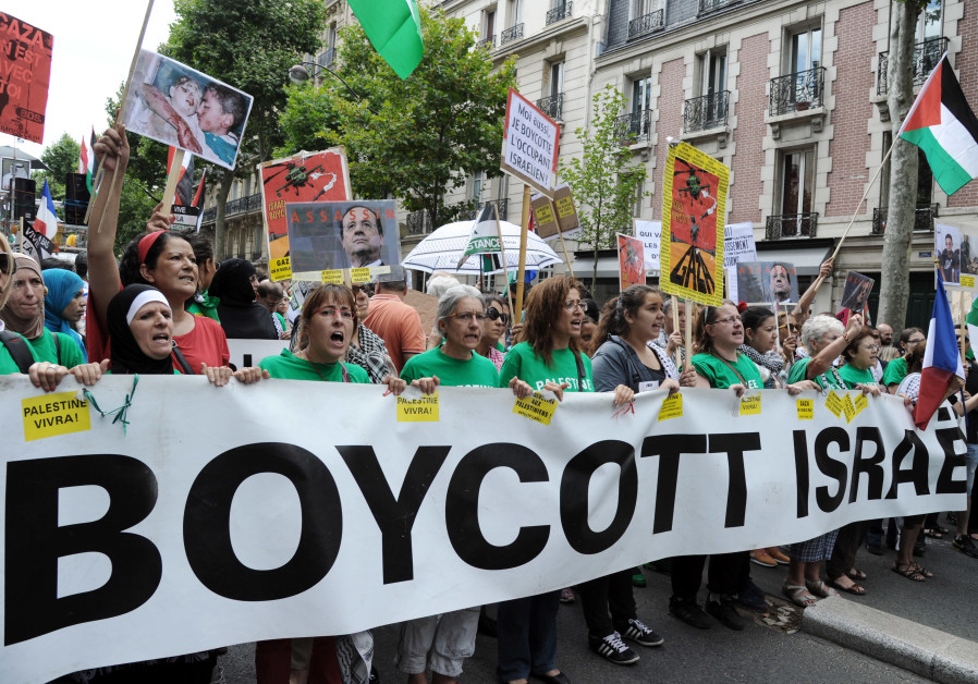 "Protesters hold abanner that reads ""Boycott Israel"" during a pro-Palestinian demonstration in Paris"