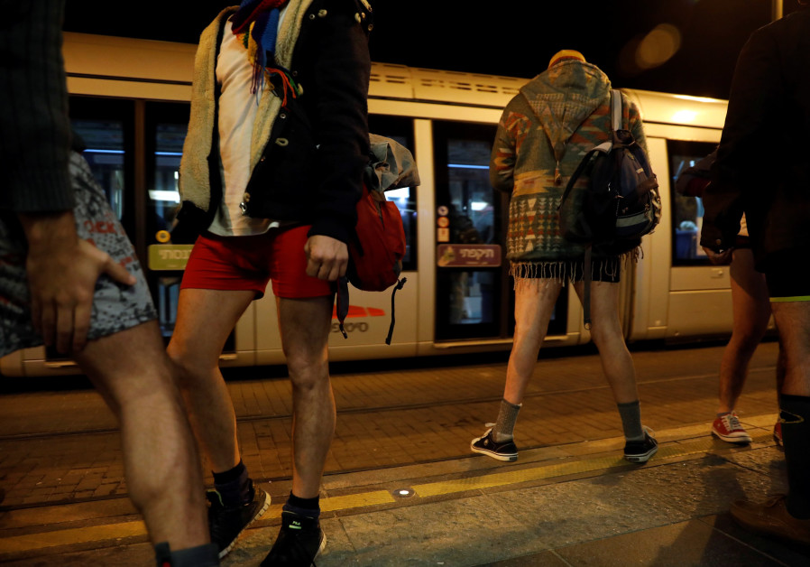 Israelis take part in the annual No Pants Day on Jerusalem's Light Rail, January 2018