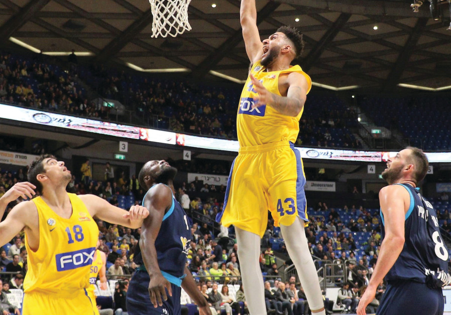 Maccabi Tel Aviv forward Jonah Bolden (center) dunks two of his 12 points during an 82-63 win over H