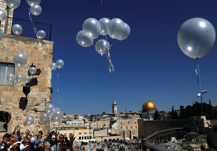 People release balloons as they celebrate a bar mitzva near the Western Wall