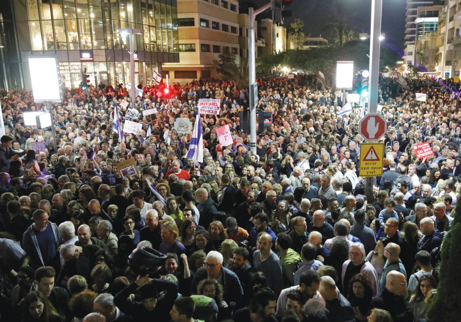 Thousands take part in a protest against alleged government corruption, in Tel Aviv, on December 2,