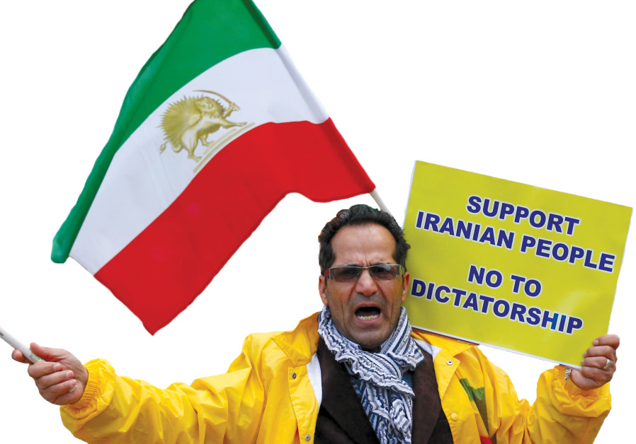 AN OPPONENT of Iranian President Hassan Rouhani chants slogans during a protest outside the European
