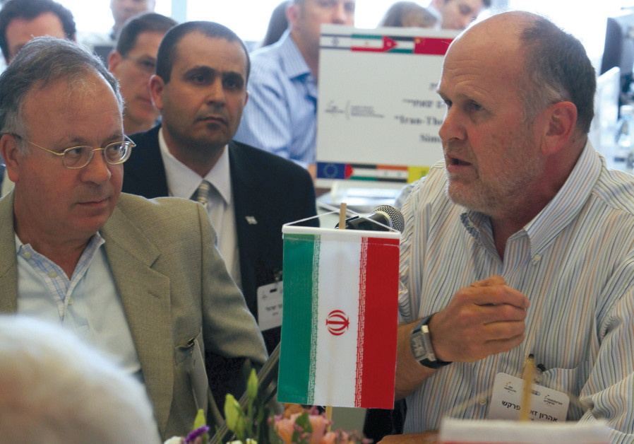 FORMER IDF intelligence chief Aharon Zeevi Farkash (right), playing Iran, sits with experts during a