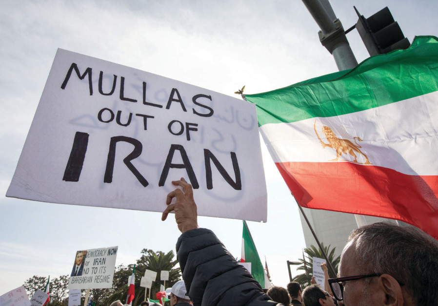 PEOPLE RALLY in support of Iranian anti-government protests in Los Angeles earlier this week