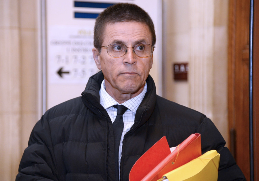 Accused synagogue arsonist Hassan Diab enters a Parisian courthouse, January 2018