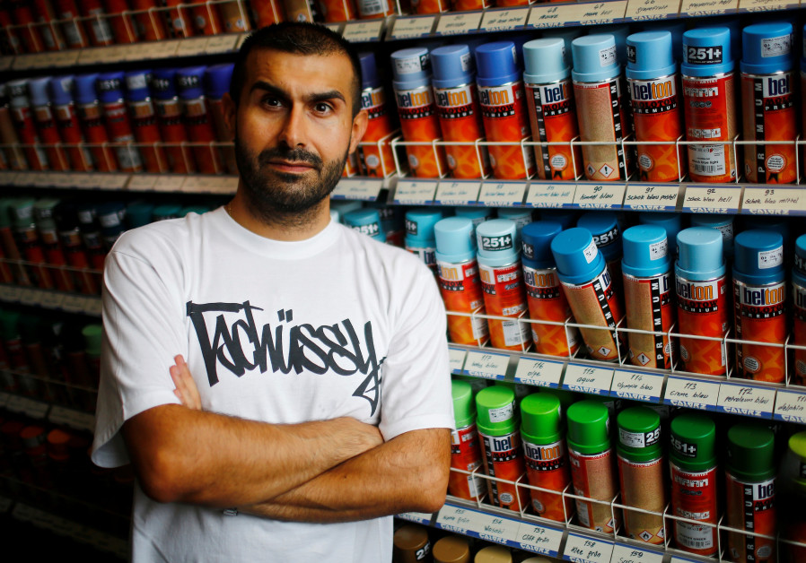 Graffiti activists in Berlin turn Nazi symbols into art