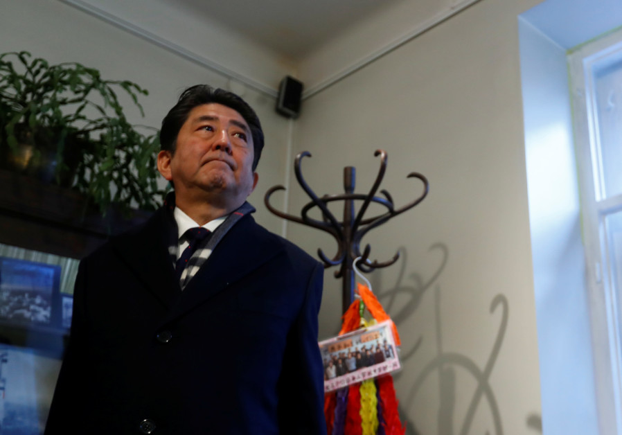 Japan's Prime Minister Shinzo Abe visits a former home of Chiune Sugihara, a Jew-saving Japanese dip