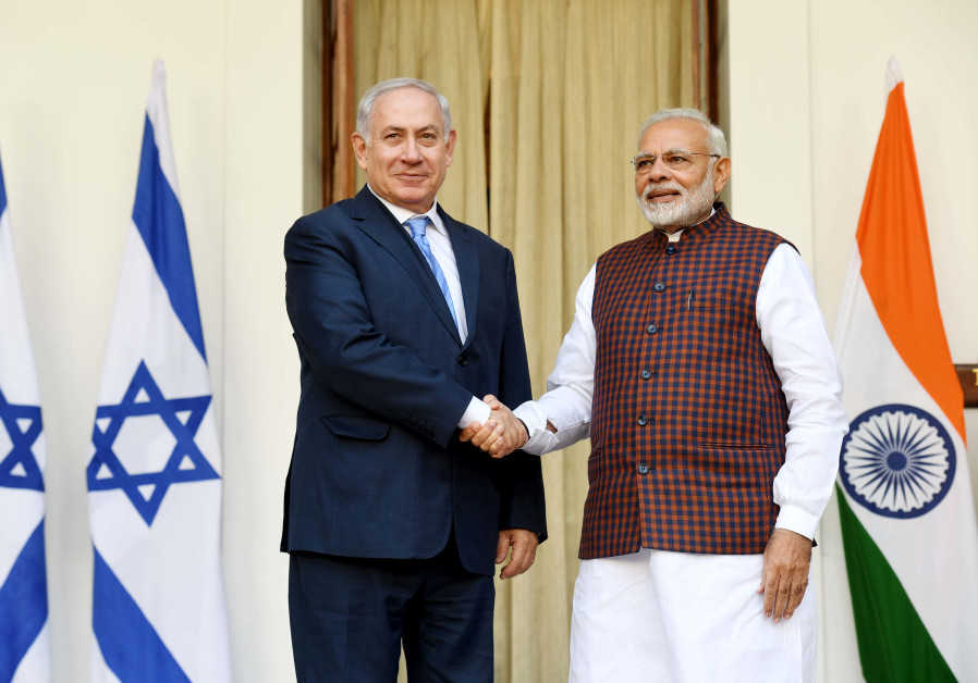 Israeli PM Netanyahu and Indian PM Modi shake hands at a press conference in New Delhi.