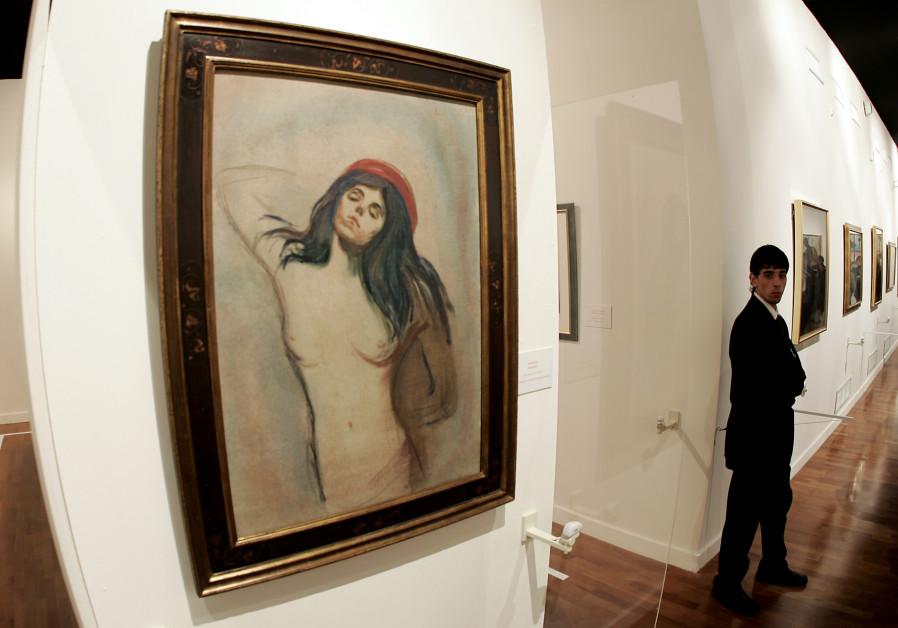"""A security guard stands near a painting of """" Madonna"""" by Norwegian artist Edvard Munch"""