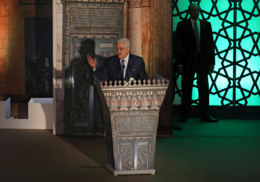 Palestinian President Mahmoud Abbas speaks during Al-Azhar's conference on Jerusalem, in Cairo, Egyp