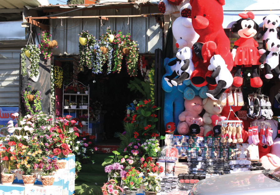 SHOPS IN Barta'a offer all sorts of kitsch, household goods, and clothing – toys, cosmetics, socks,