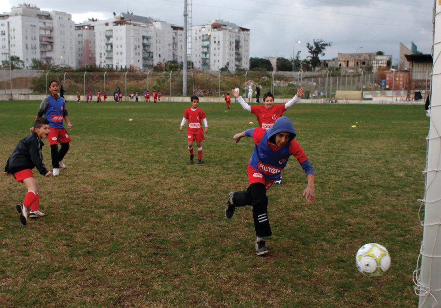 ARAB AND Jewish boys play soccer during a tournament to promote closeness, cooperation and coexisten
