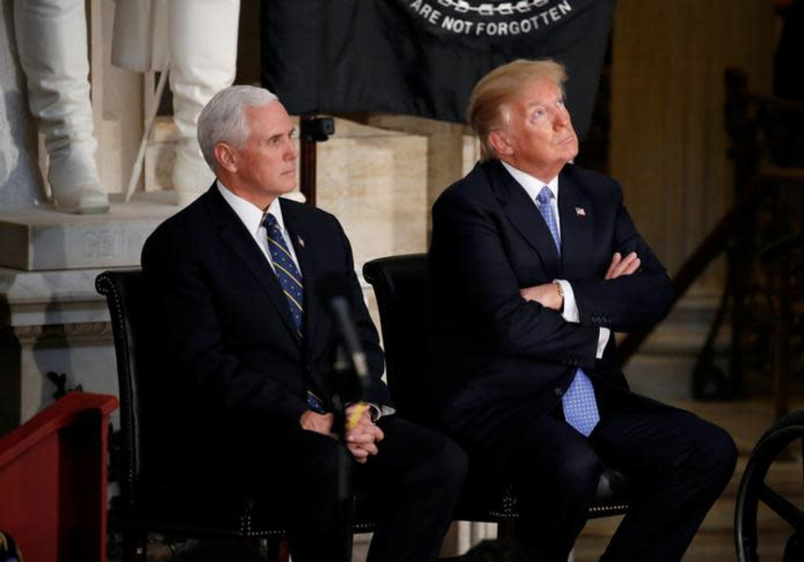 US President Donald Trump looks at the Capitol Rotunda as he sits with US Vice President Mike Pence