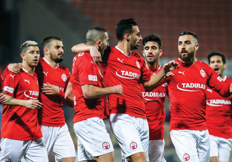 Hapoel Beersheba players celebrate.
