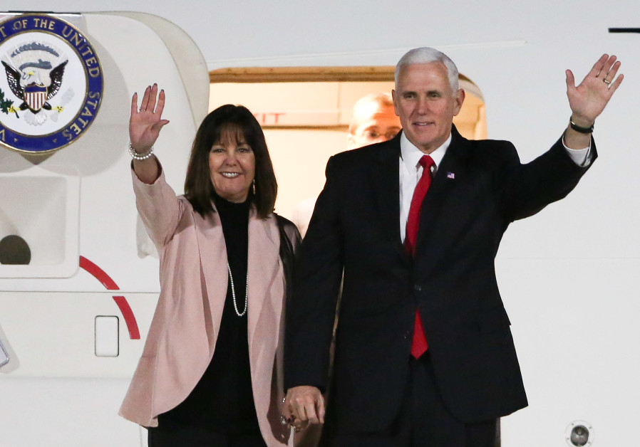 US Vice President Mike Pence and his wife Karen Pence wave upon their arrival in Amman, Jordan