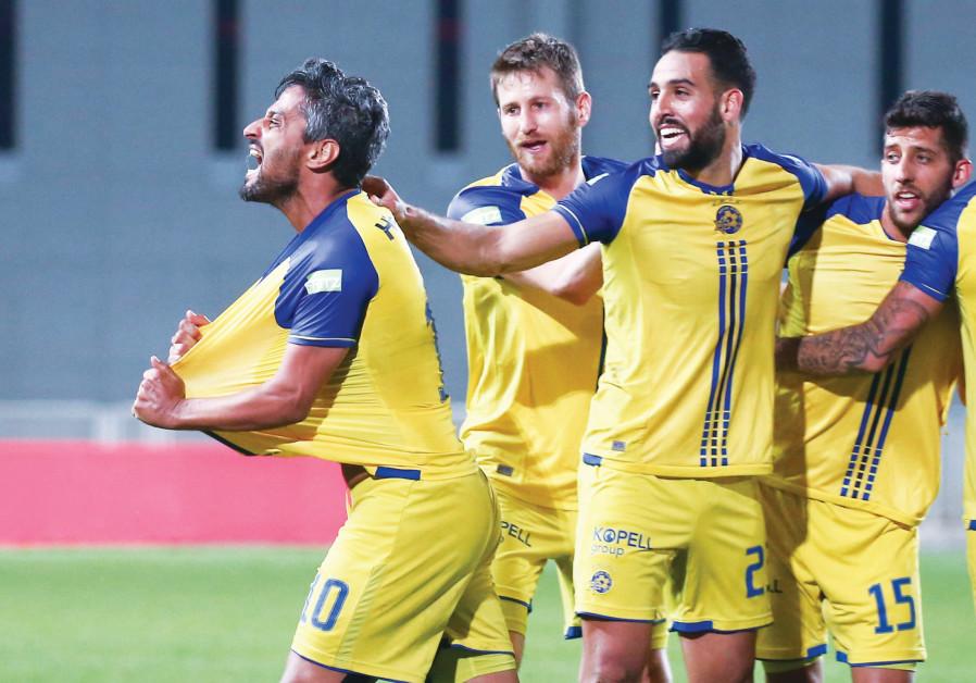 Maccabi Tel Aviv striker Barak Itzhaki (left) celebrates with teammates.
