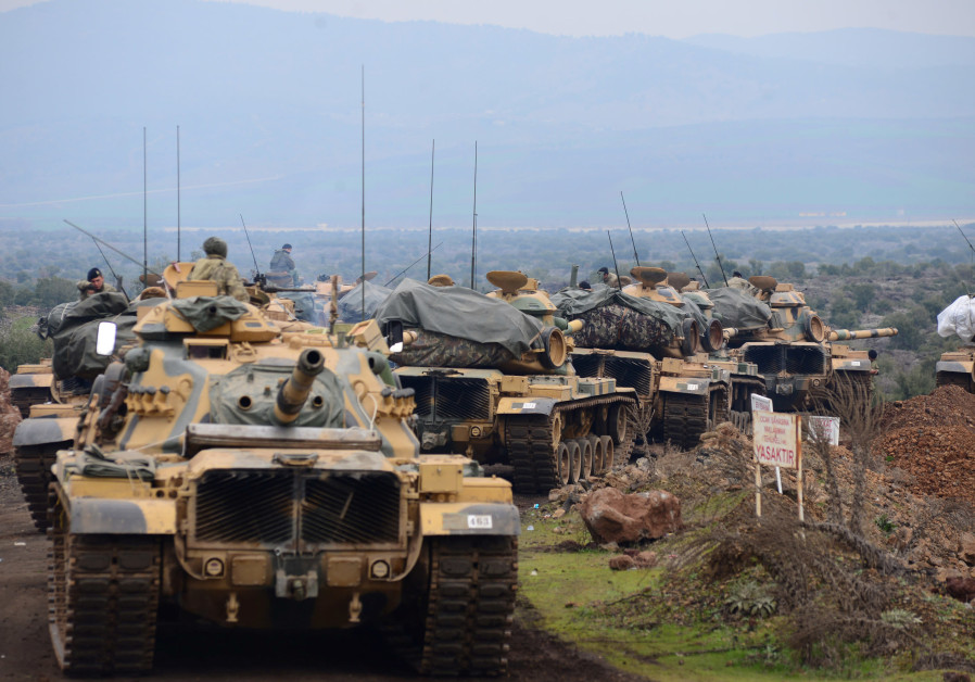 Turkish soldiers are seen near the town of Hassa on the Turkish-Syrian border in Hatay province, Tur