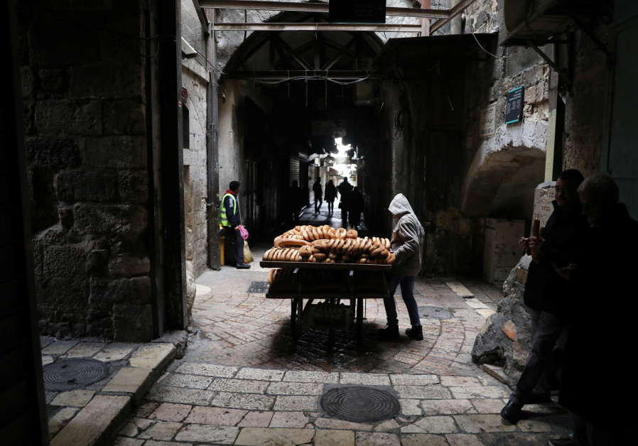 A man sells bread in the nearly-empty Muslim quarter of Jerusalem's Old City during the Palestinian'