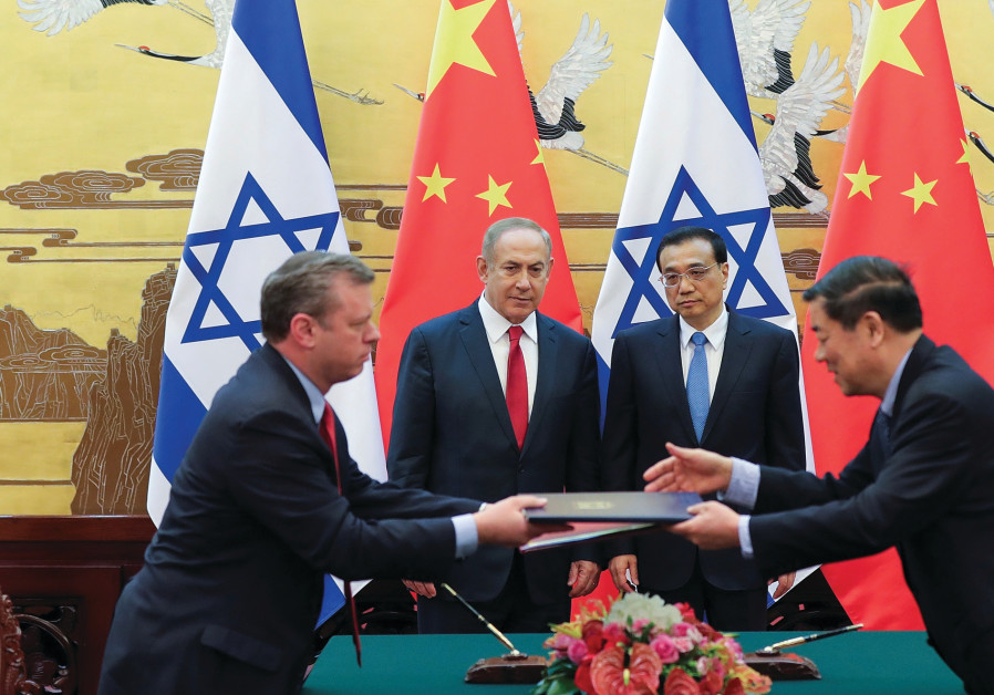 Chinese Premier Li Keqiang and Prime Minister Benjamin Netanyahu oversee a signing ceremony at the G