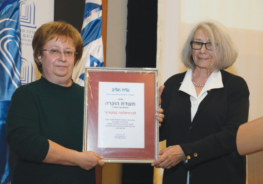Ann Kirson Swersky (right), the founder and chairperson of Siah Vasig, presents a special award to d