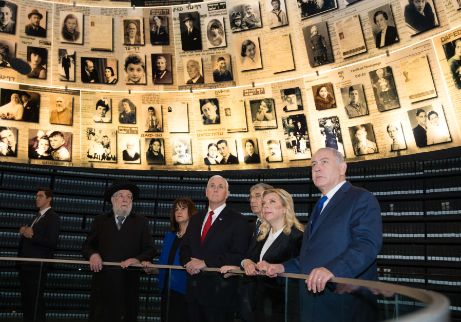 US Vice President Mike Pence and wife Karen listen to a guide with the Netanyahus at Yad Vashem